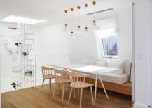 Minimal design of the banquette accentuates the Scandinavian style of the dining area