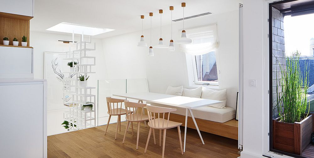 Minimal design of the banquette accentuates the Scandinavian style of the dining area [From: kozac]