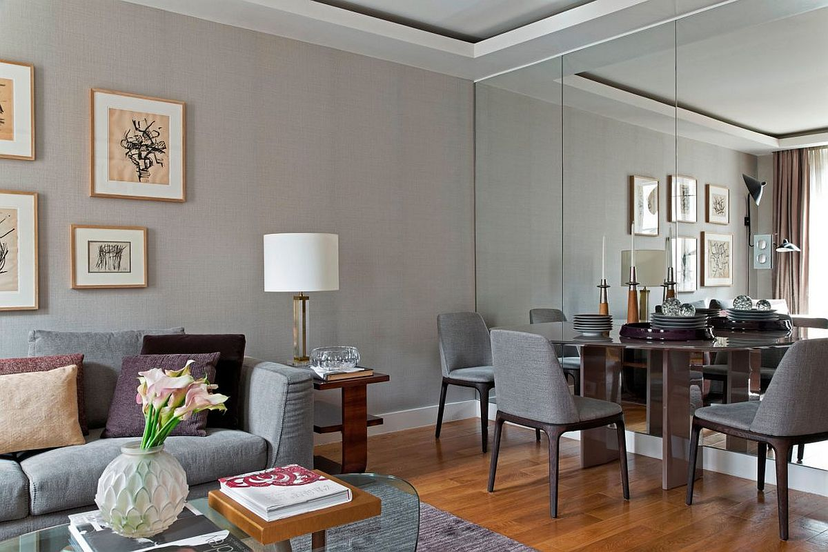 Mirrored walls in the dining are agive it a spacious visual appeal