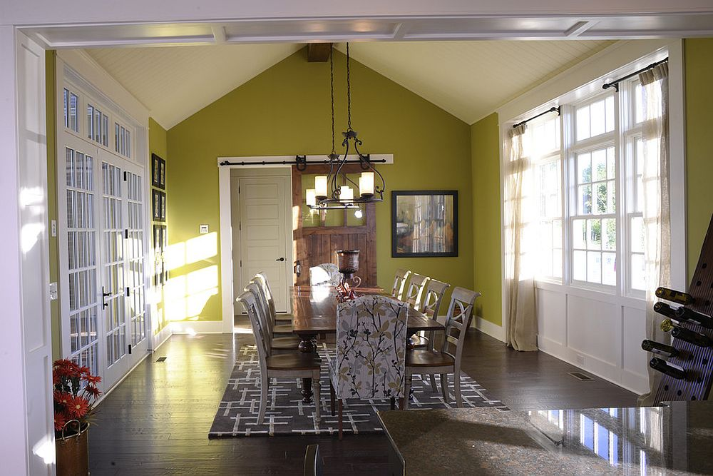 Modern dining room in green with sliding barn door [From: Weaver Custom Homes]