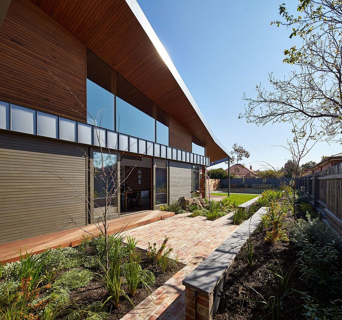Modern family home in Melbourne with garden around it