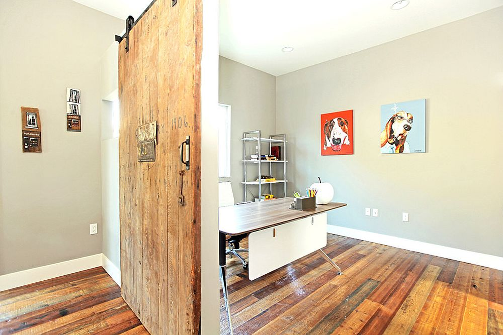 Modern home office with reclaimed wood flooring and a cool sliding barn door [Design: True American Grain]