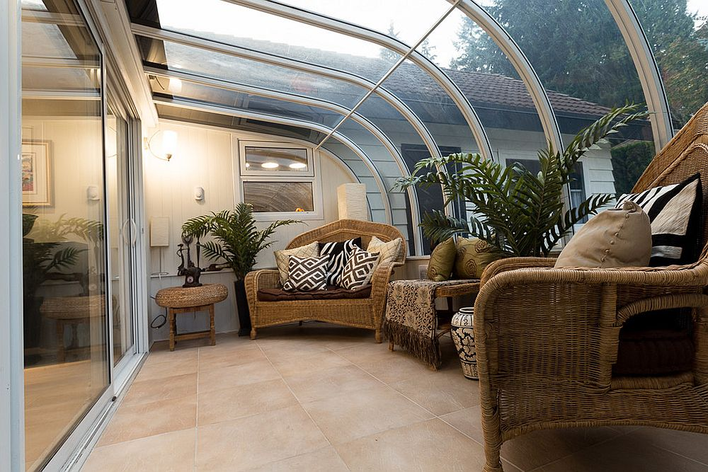 Modern tropical sunroom that borrows from the glassy style of a conservatory