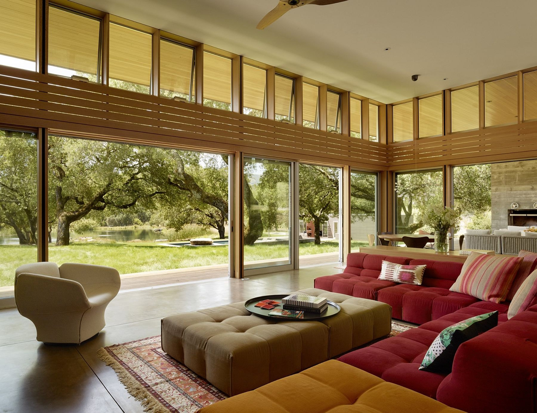 Modular seating and relaxing natural views epitomize the stylish living room of the Sonoma Residence