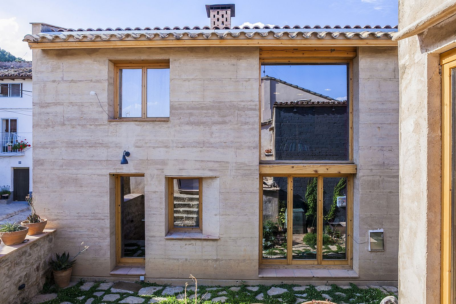 Natural materials combined with modern design at the 21st Century Vernacular Home