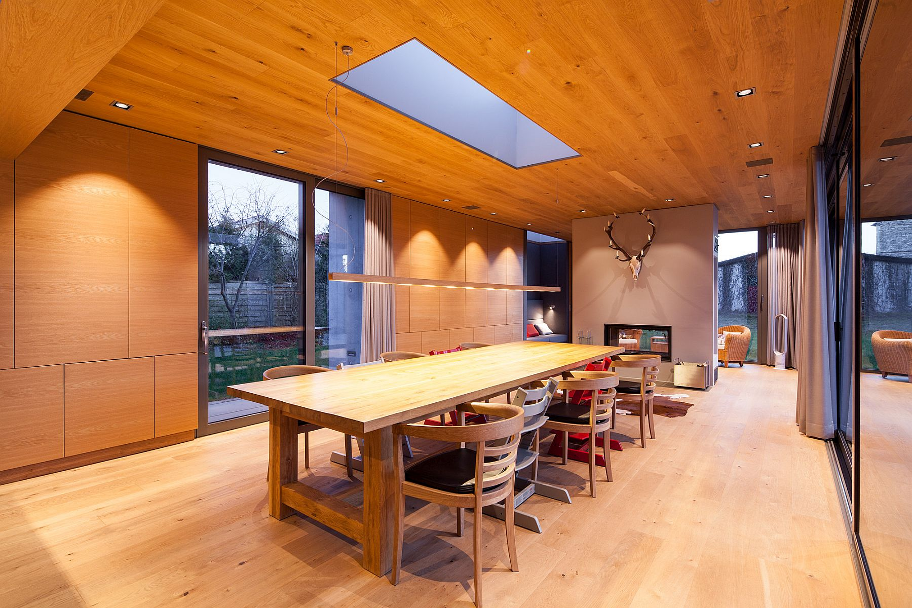 Oke celing and floors coupled with wooden walls and a cozy fireplace in the dining room