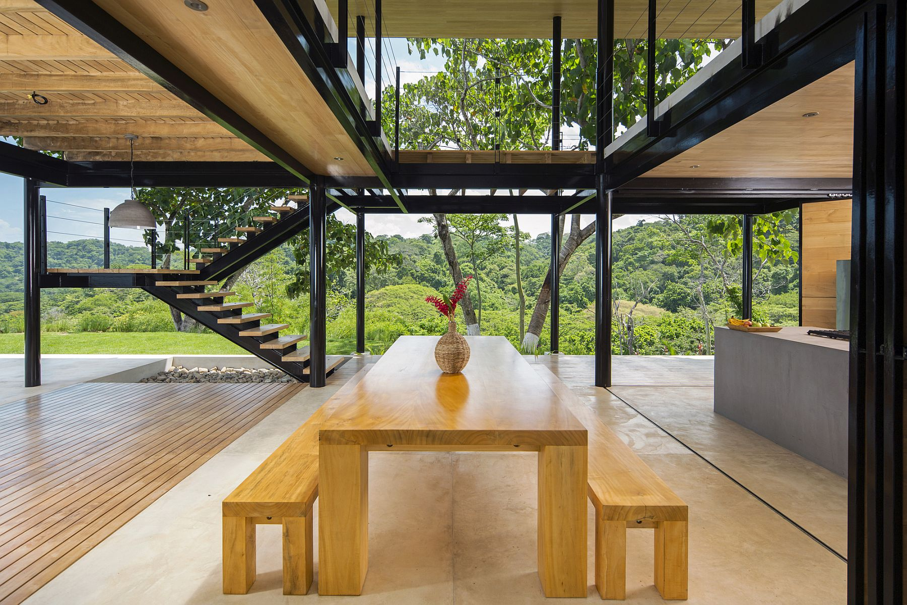 Open dining area and kitchen of the breathtaking family home in Costa Rica