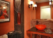 Orange coupled with wood in dark stain in the vivacious powder room