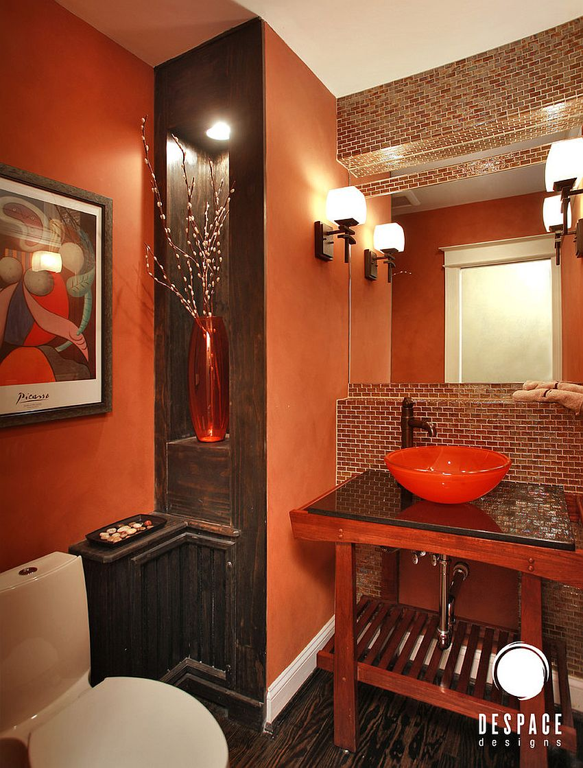 Orange coupled with wood in dark stain in the vivacious powder room [Design: De Space Designs]