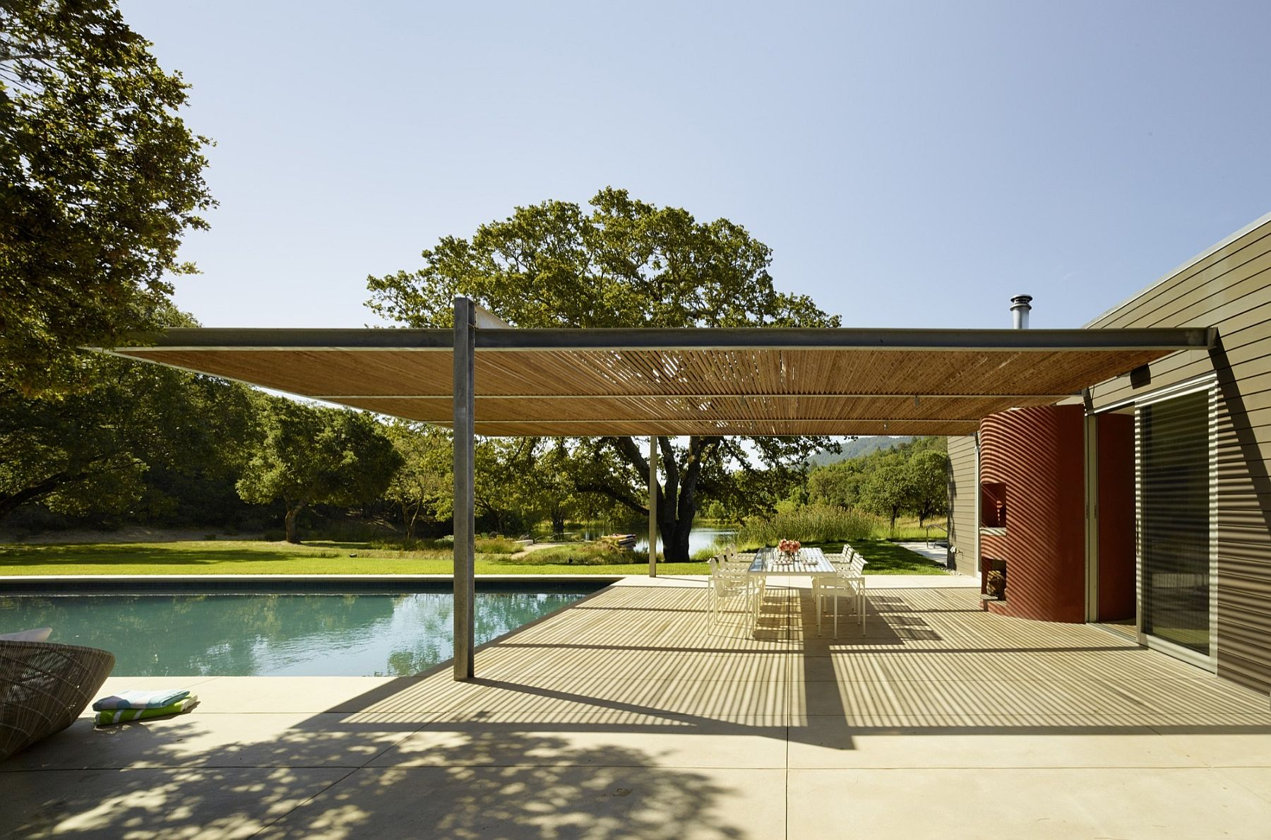 Outdoor living, dining and guest spaces become a part of the open interior and the green landscape