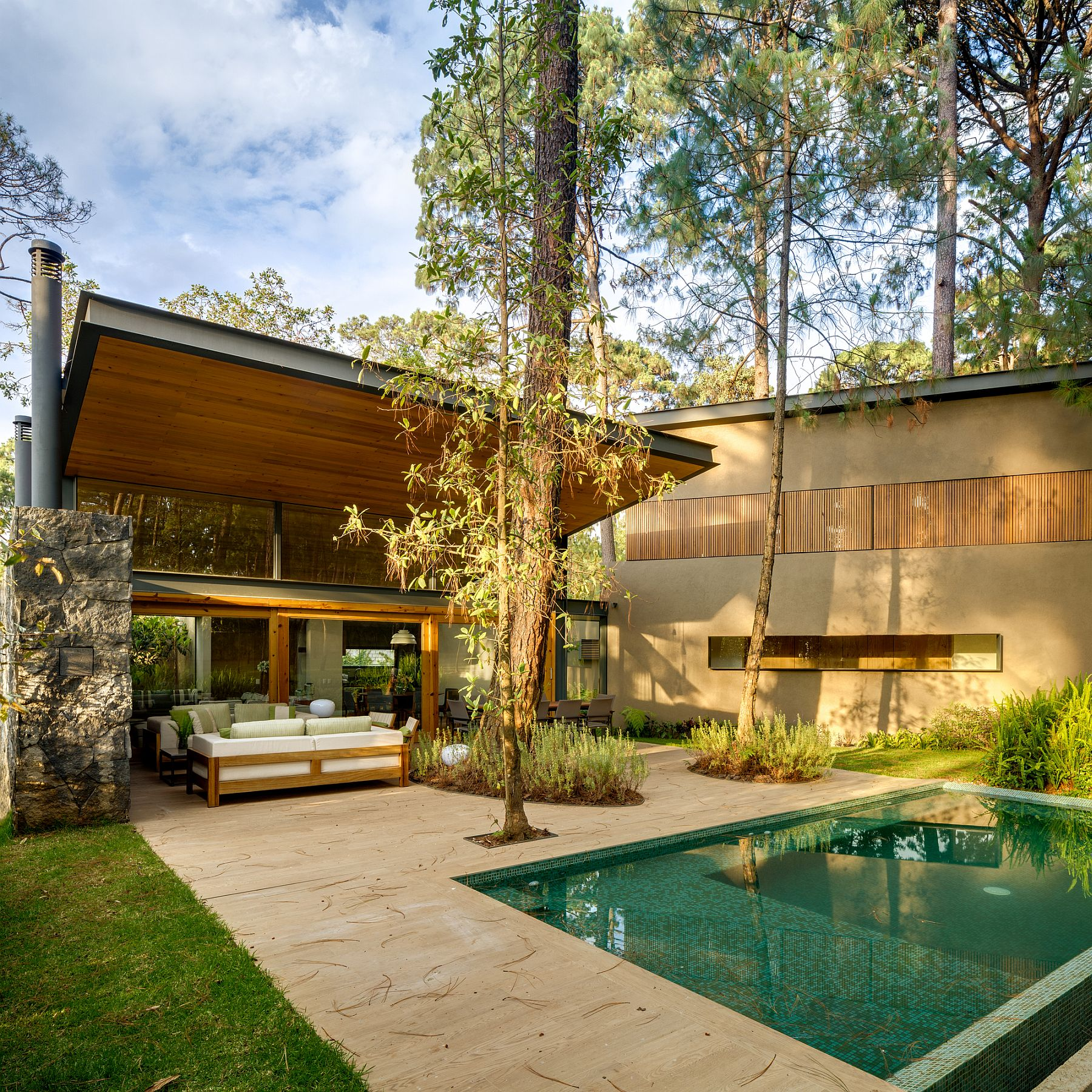 Outdoor pool and Jacuzzi add luxury to the nature-centric homes