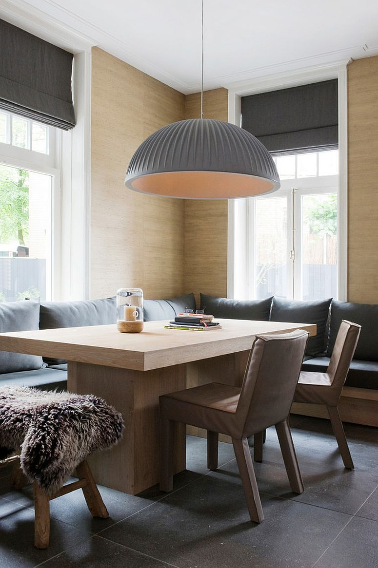 Oversized pendant in gray for the lovely banquette dining [Design: Baden Baden Interior / Photography: Marjon Hoogervorst]