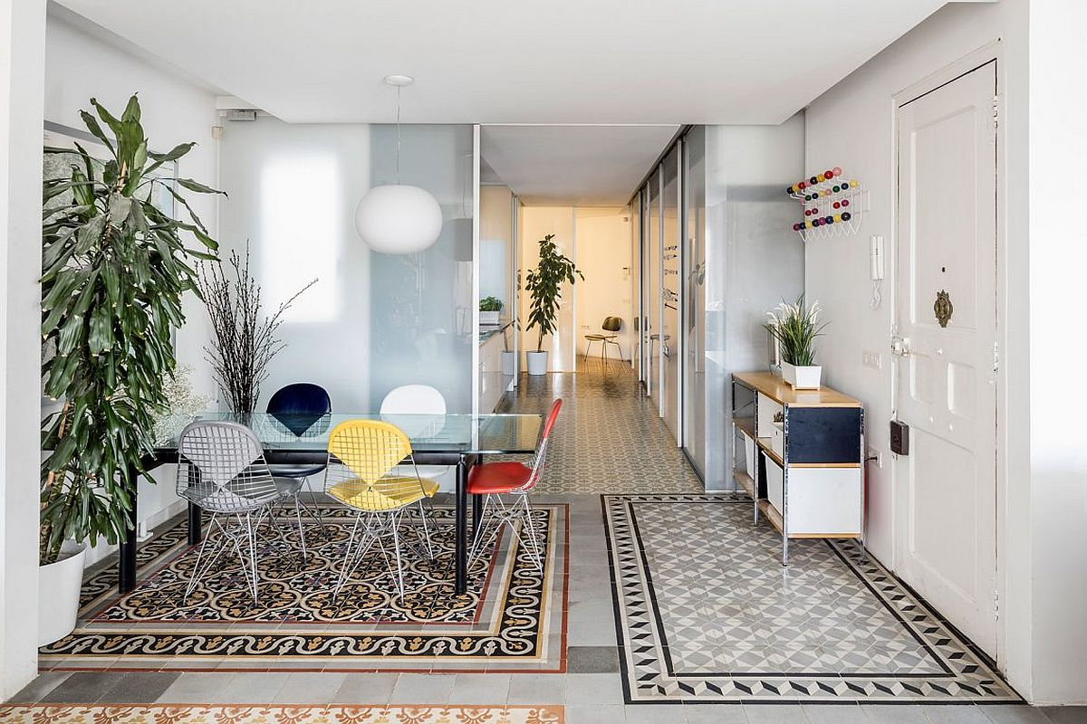 Partitions inside the renovated home allow light to flow through freely