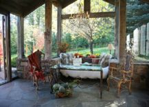 Picture-perfect rustic sunroom with sitting nook and unassuming decor