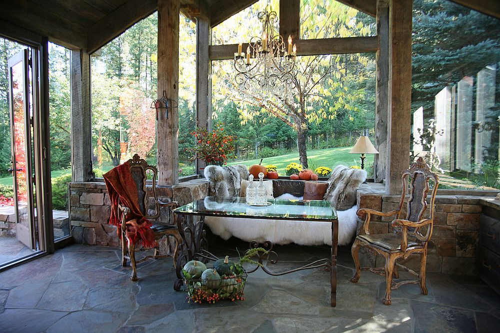 Picture-perfect rustic sunroom with sitting nook and unassuming décor [Design: Alexandra Lauren Designs]