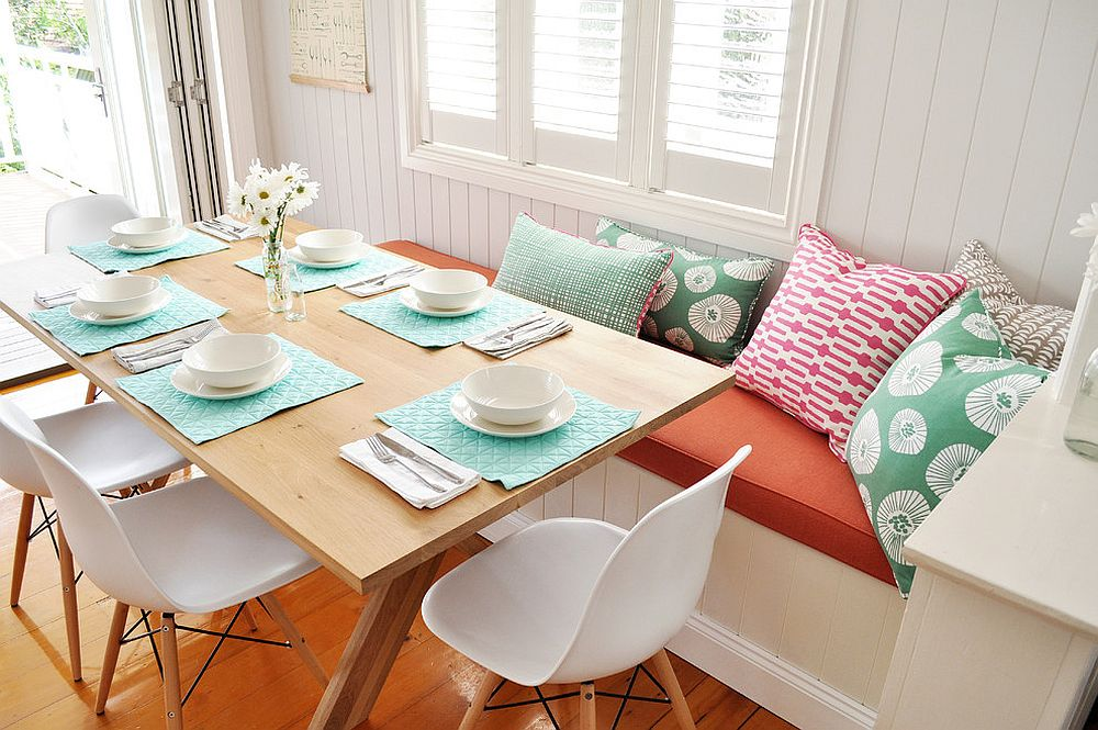 Pillows add color to the beautiful banquette dining space [Design: Greenwood's Home]