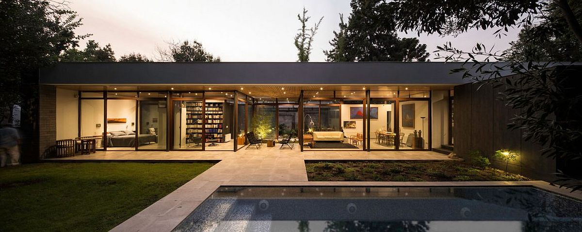 Pool area and garden of the stylish and open Chilean house