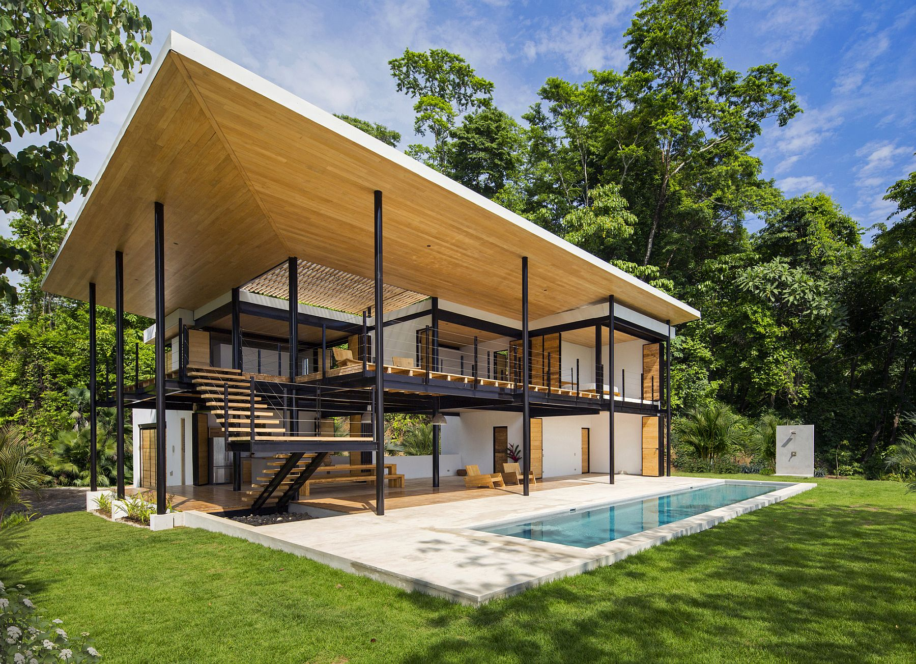 Rear facade of the Ocean Eye with a series of terraces and pool