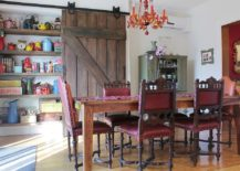 Reclaimed-barn-door-in-the-dining-room-hides-a-large-shelf-217x155