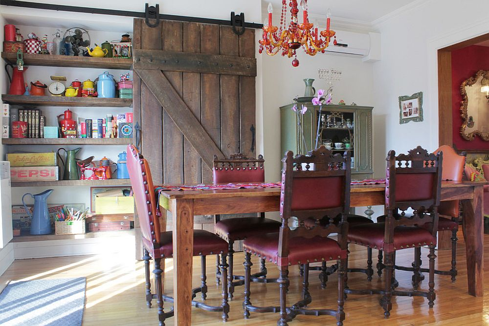 Reclaimed barn door in the dining room hides a large shelf [From: Esther Hershcovic]