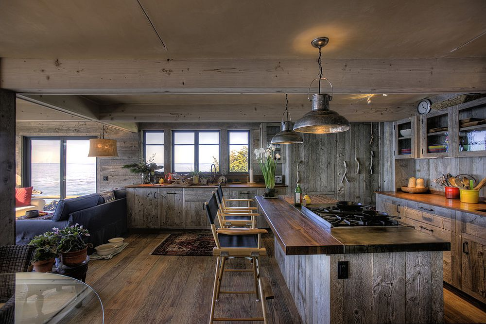 Reclaimed teak brings class and durability to this beach style kitchen [Design: Simmons and Company]