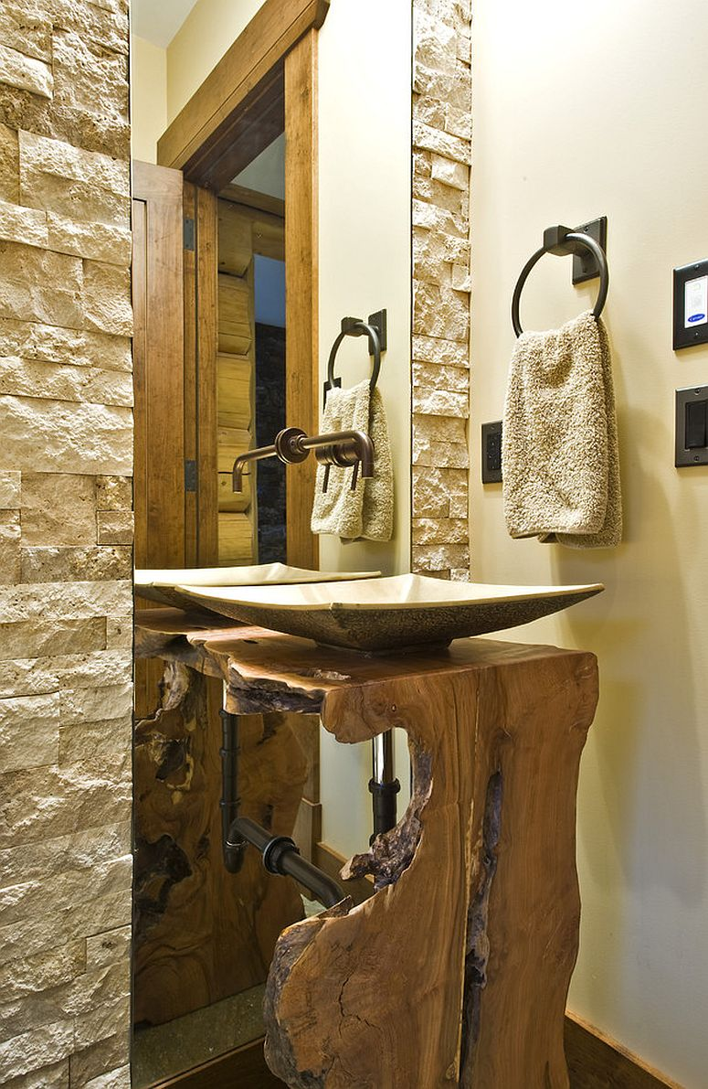 Reclaimed trees used to craft live edge vanity for the rustic bathroom [From: Sticks and Stones Design Group]