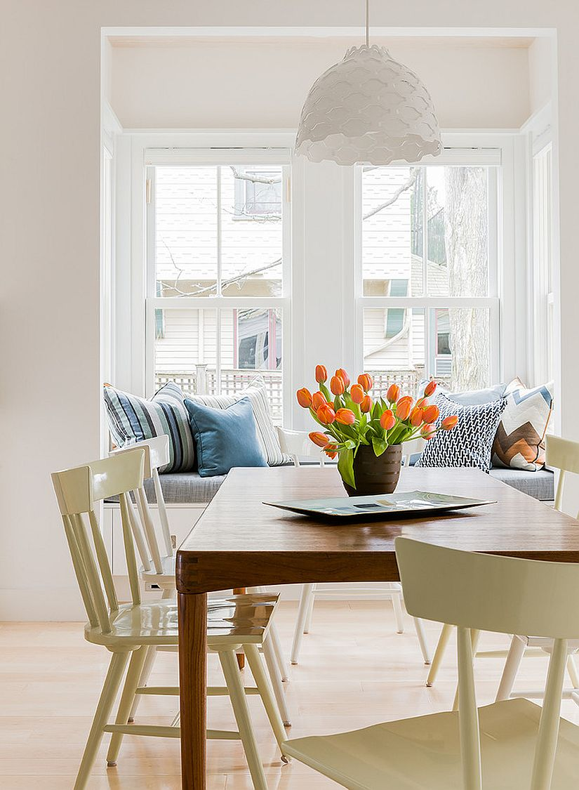 Relaxing banquette next to the window for the Scandinavian dining room [Design: Terrat Elms Interior Design]