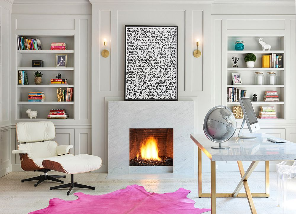 Relaxing contemporary home office in white with a fireplace, Eames Lounger and colorful rug [Design: Palmerston Design Consultants]