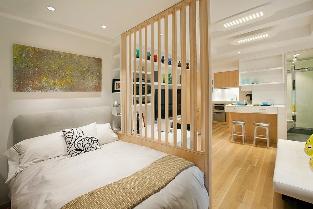 Room divider separates the bedroom from the living area in this New York micro-apartment