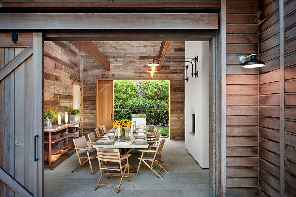Rustic dining room utilizes space-saving sliding barn door [Design: John Hummel & Associates Custom Builders]