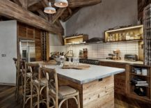 Rustic kitchen island draped in reclaimed wood