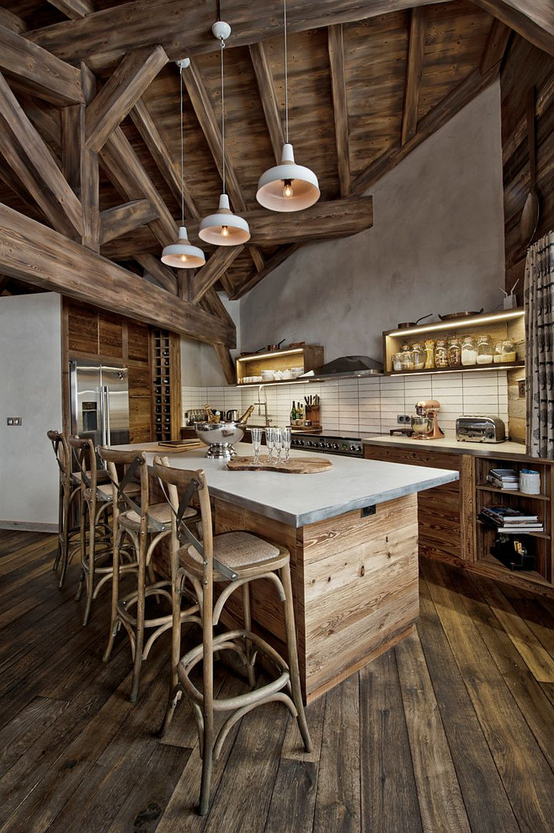 Rustic kitchen island draped in reclaimed wood [Design: Inspired Dwellings]