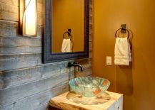 Rustic powder room with reclaimed wood accent wall and orange wall in matte finish