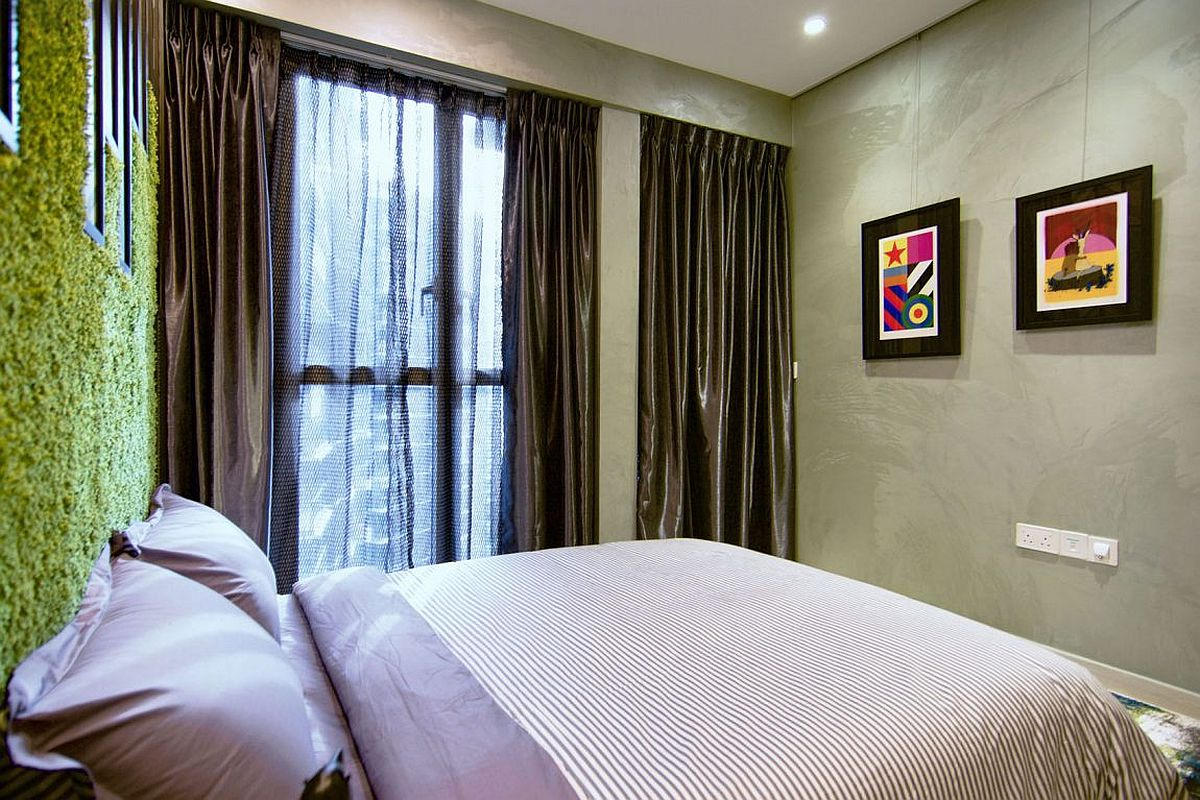 Silken drapes and walls with texture make a bold statement inside the bedroom