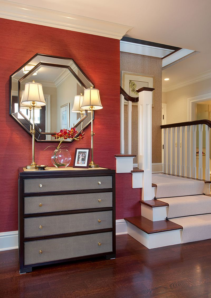 Simple and elegant entry with red grasscloth wallcovering, dashing mirror and a lovely console [From: Julians Interiors / Giovanni Photography]
