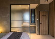 Simple screen works as an efficient room divider in the rustic bedroom