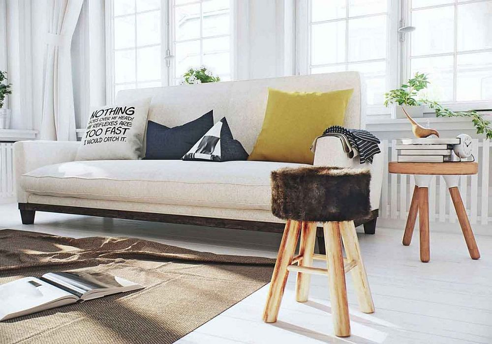 Simple stools used as side tables in the Scandinavian living space