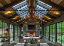 Skylights bring in additional ventilation into the stunning rustic sunroom