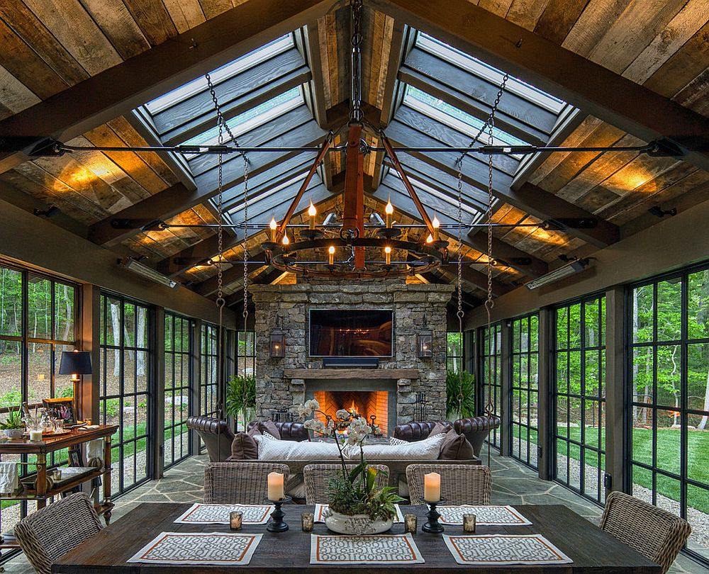 Skylights bring in additional ventilation into the stunning rustic sunroom [Design: Carolina Timberworks]