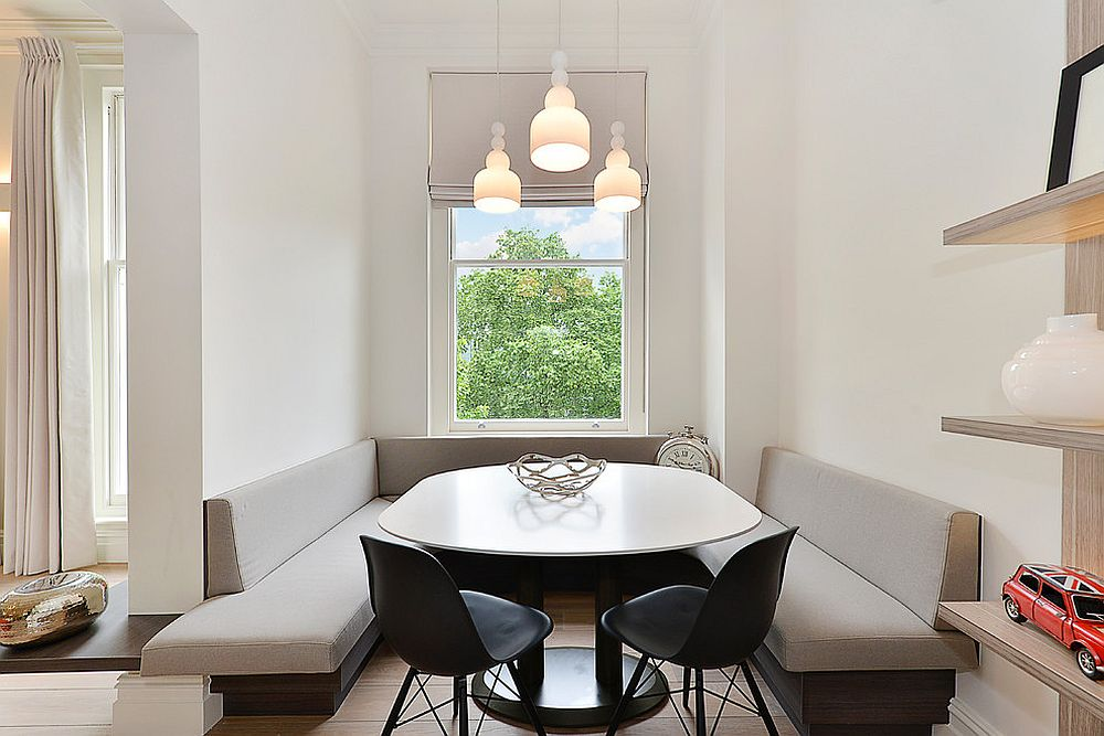 Sleek built-in banquette seating in neutral hues is perfect for the Scandinavian dining nook
