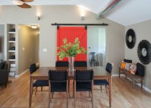 Sliding door brings a touch of bright red to the dining room 217x155 25 Diverse Dining Rooms with Sliding Barn Doors