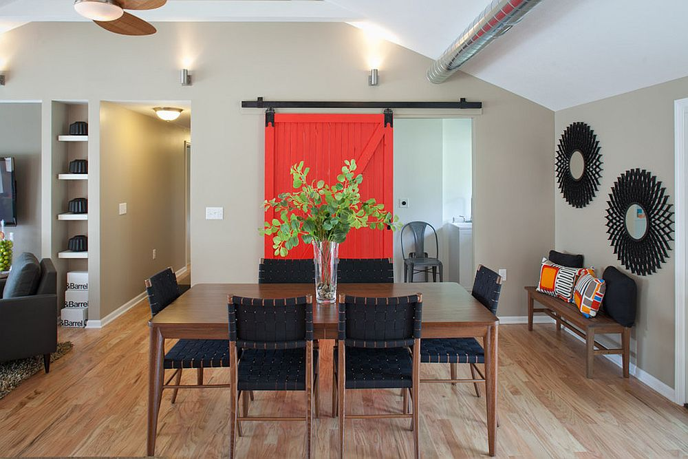 Sliding door brings a touch of bright red to the dining room [Design: Nest Designs LLC]