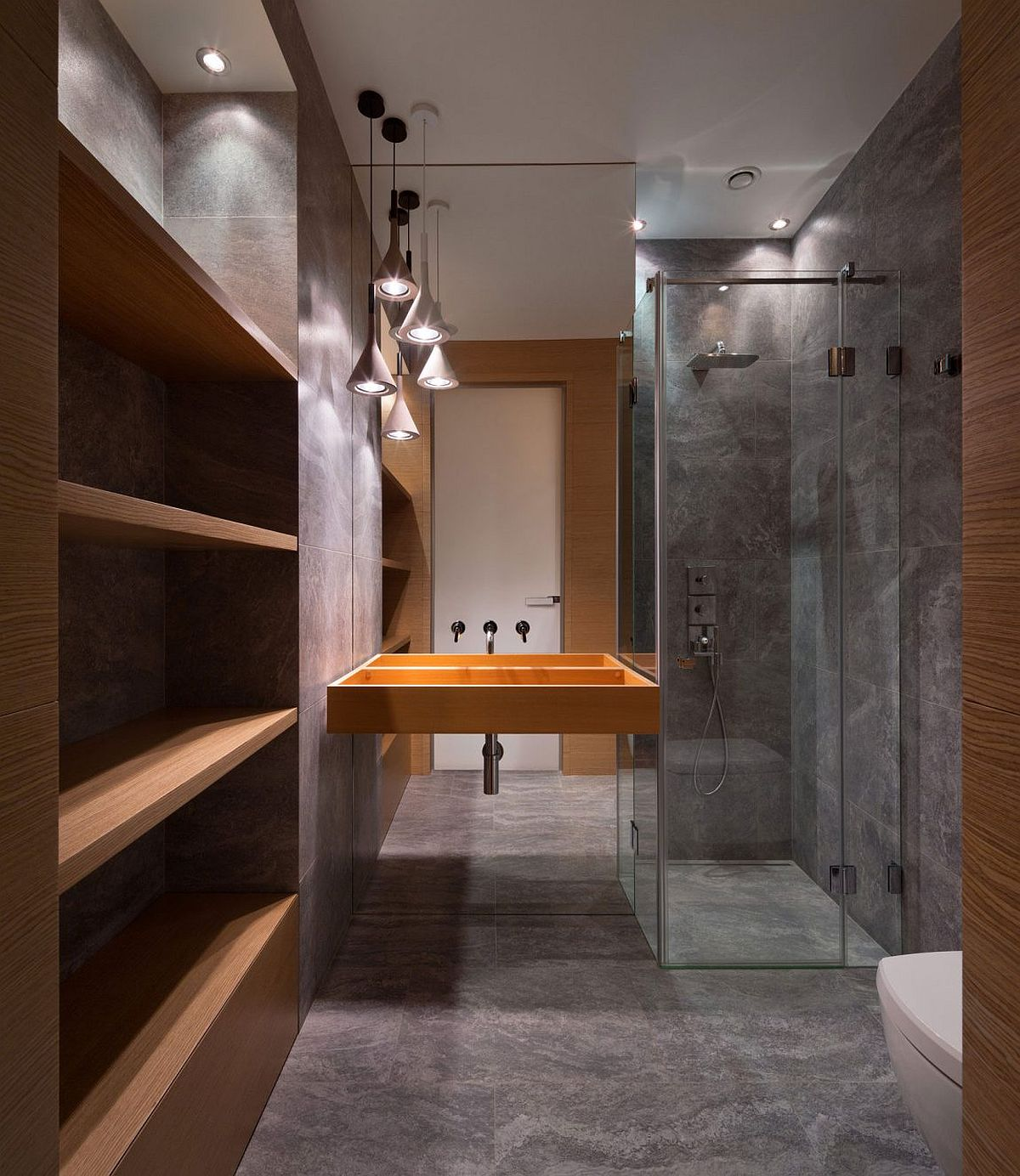 Smart modern abthroom with textured walls and glass shower area