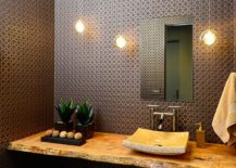 Sophisticated contemporary powder room with a live edge vanity