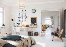 Spacious Scandinavian bedroom design in white with small workstation