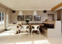 Spacious and cheerful Scandinavian dining room with a large banquette