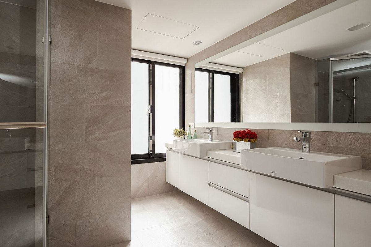 Spacious bathroom with large floating vanity in white