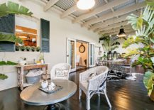 Spacious sunroom with dining space and relaxing lounge