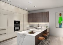 Sparkling contemporary kitchen in white with marble island