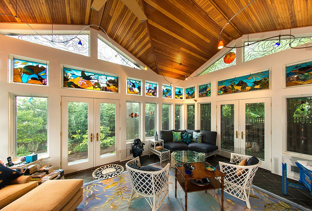Stained glass and ingenious rug bring tropical vibe to the sunroom [Design: Howard Katz Architects]